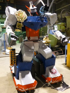 HJM-47 with champion belt of the Robot Battle Tournament
